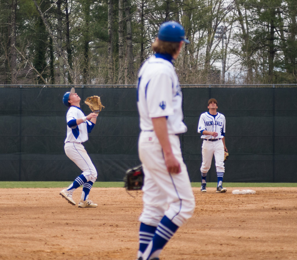 Chadwick Feeley prepares to catch a fly ball while Austin Crane