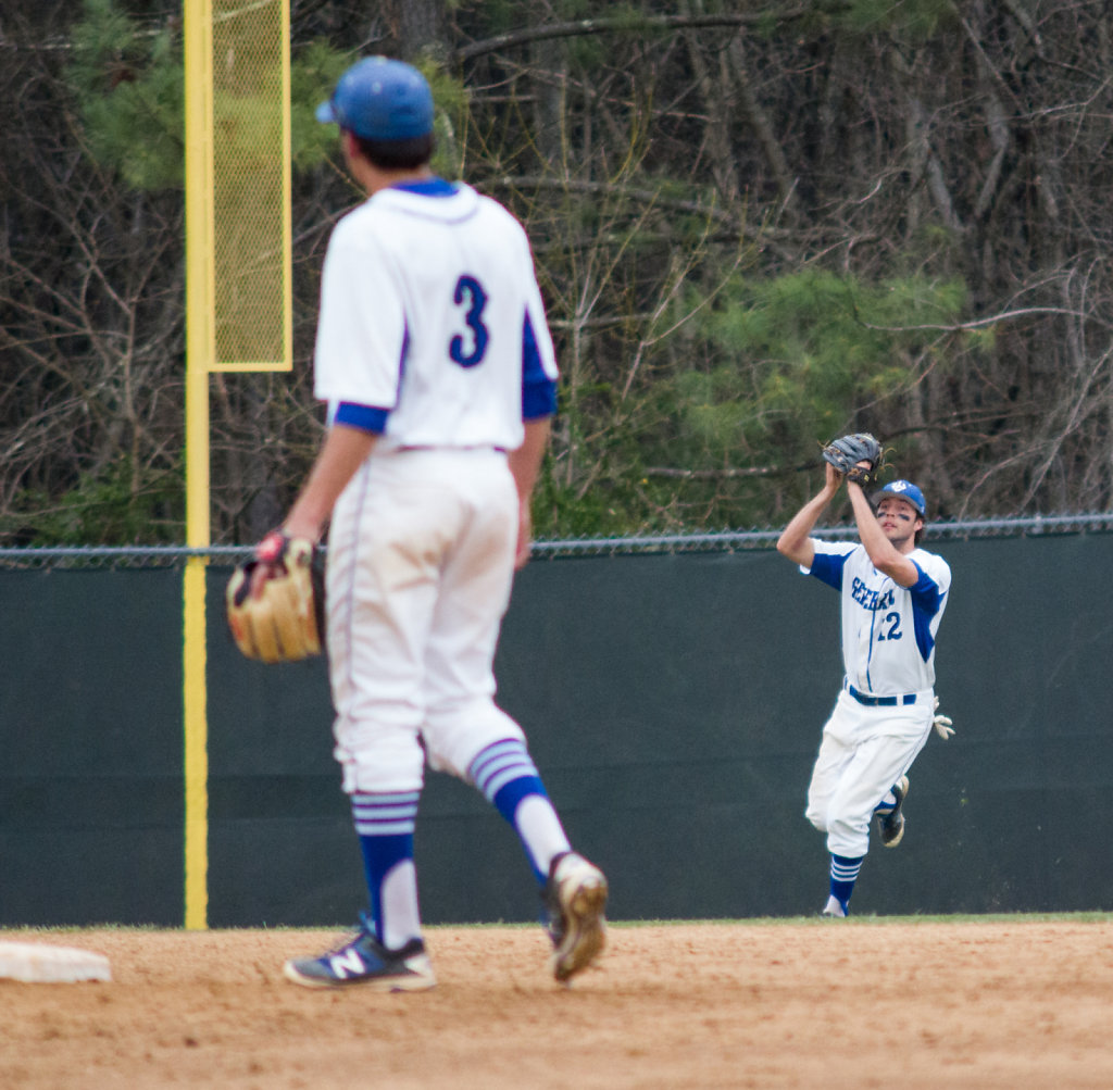 Matt Wasson makes a catch while Austin Crane looks on