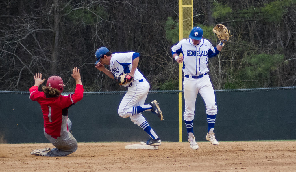 Austin Crane gets the out with Chadwick Feeley airborne nearby