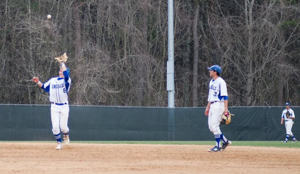 Chadwick Feeley making the catch with Austin Crane and Matt Wass
