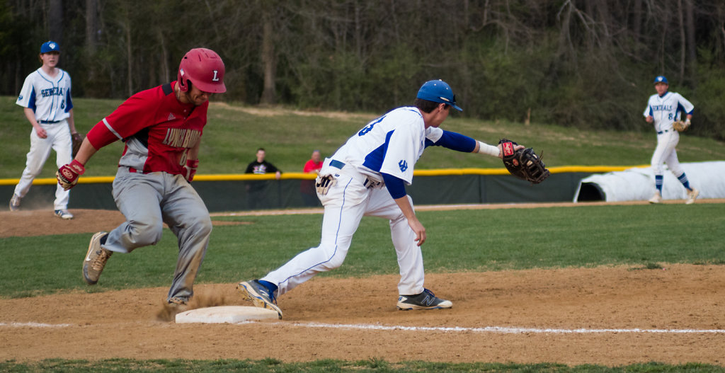 Jonny Swenson gets the out with Danny Deveraux and Chadwick Feel